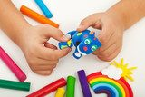 Child playing with colorful clay - closeup on hands  Fototapety do Przedszkola Fototapeta