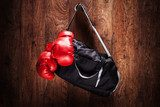 Sports bag and boxing gloves hanging on a wall  Sport Fototapeta