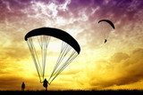 Paragliding at sunset  Sport Fototapeta