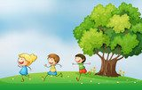 Three energetic kids playing at the hilltop with a big tree  Pokój dziecka Plakat
