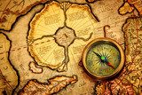 Vintage compass lies on an ancient map of the North Pole.  Mapa Świata Fototapeta