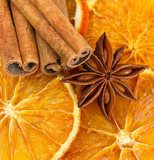 Cinnamon sticks, star anise and dried orange cuts  Fototapety do Kawiarni Fototapeta