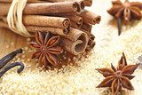 Cinnamon sticks, brown sugar and anise stars  Fototapety do Kawiarni Fototapeta