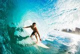 Surfer on Blue Ocean Wave in the Tube Getting Barreled  Sport Fototapeta