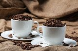 Two coffee cups with coffee beans.  Kawa Fototapeta