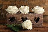 Beautiful white roses in decorative box on wooden table  Plakaty do Sypialni Plakat