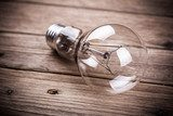 bulb on the brown wooden background  Biuro Plakat