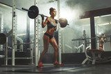 Woman lifting weight in gym  Sport Plakat