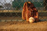 Baseball and Glove against the Fence  Sport Plakat