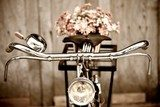 Old bicycle and flower  vase  Pojazdy Fototapeta