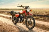 Classic old motorcycle on a dirt road.  Pojazdy Fototapeta