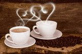 Coffee beans and coffee cup with heart- shaped steam  Kawa Fototapeta