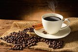 Coffee cup and coffee beans on old wooden background  Kawa Fototapeta