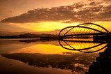 Modern bridge by the lakeside in Putrajaya, Malaysia at sunrise  Fototapety Mosty Fototapeta