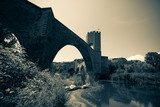 medieval stone bridge over river. Imitation of old image  Fototapety Mosty Fototapeta