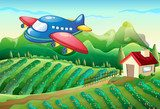An airplane above the farm with a house  Fototapety do Pokoju Chłopca Fototapeta