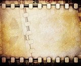 Old motion picture reel with film strip.  Fototapety Sepia Fototapeta