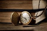 vintage pocket clock and old books  Sepia Fototapeta