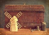 Vintage wooden boxes and model windmill. retro concept  Sepia Fototapeta
