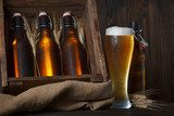 Beer glass with wooden crate full of beer bottles and wheat ears  Plakaty do kuchni Plakat