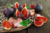 Tasty figs with ham on grey wooden table  Kuchnia Plakat