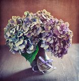 purple hydrangea flowers and a wooden heart on a table.  Obrazy do Sypialni Obraz