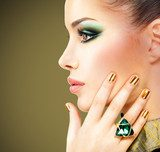 Glamour woman with beautiful golden nails and emerald ring  Ludzie Obraz