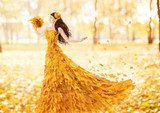 Autumn woman in fashion dress of fall maple leaves, artistic  Ludzie Obraz