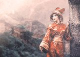 Woman in Chinese princess costume in the pine forest  Orientalne Fototapeta