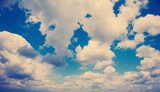 White fluffy clouds over blue sky  Niebo Fototapeta