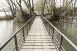 Old wooden bridge in a lake  Mosty Fototapeta