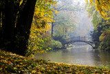 Autumn - Old bridge in autumn misty park  Fototapety Mosty Fototapeta