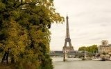View of the Eiffel tower, moving subway train autumn trees  Wieża Eiffla Fototapeta