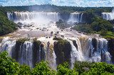 Beautiful Cascade of waterfalls with clouds and jungle. Iguassu  Wodospad Fototapeta