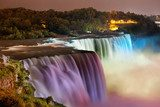 Niagara Falls lit at night by colorful lights  Fototapety Wodospad Fototapeta