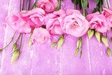 Beautiful eustoma flowers on wooden background  Kwiaty Plakat