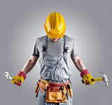 builder in a helmet with a hammer and a wrench  Ludzie Plakat