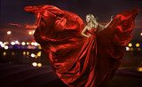 woman dancing in silk dress, artistic red blowing gown waving  Ludzie Plakat