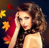 Girl with colourful autumn leaves hairstyle and makeup  Ludzie Plakat