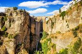Bridge of Ronda, a famous white villages of Malaga, Spain a  Architektura Plakat