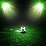 Soccer ball on the green field with lightnings  Stadion Fototapeta