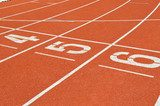 numbers on running tracks of outdoor athletic stadium  Stadion Fototapeta