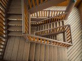 Wooden staircase in building  Schody Fototapeta