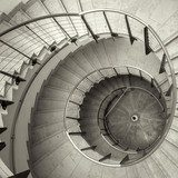 Upside view of a spiral staircase  Schody Fototapeta