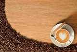 Top view of coffee cup and coffee beans on old wooden background  Fototapety do Kawiarni Fototapeta