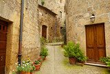 Vintage street decorated with flowers, Tuscany, Italy  Uliczki Fototapeta