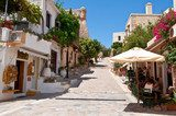 Tourists have a rest in Rethymno city. Crete island, Greece.  Uliczki Fototapeta