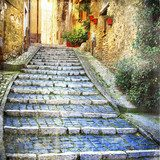 charming  old streets of  medieval villages of Italy  Uliczki Fototapeta