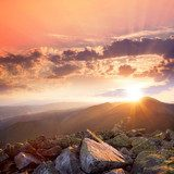Sunset in the mountains landscape. Dramatic sky,  colorful stone  Krajobrazy Obraz