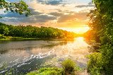 Sunset over the river in the forest  Krajobrazy Obraz